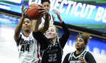 Connecticut forward Aubrey Griffin (44) works for the ball against Georgetown forward Taylor Baur (32) in the first half of an NCAA college basketball game Saturday, Jan. 23, 2021, in Storrs, Conn. (David Butler II/Pool Photo via AP)