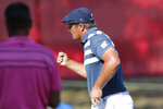 Bryson DeChambeau pumps his fist after his birdie putt on the 18th green during the final round of the Rocket Mortgage Classic golf tournament, Sunday, July 5, 2020, at Detroit Golf Club in Detroit. (AP Photo/Carlos Osorio)
