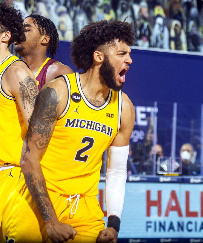 Michigan forward Isaiah Livers (2) reacts after making a basket in the second half of an NCAA college basketball game against Minnesota at Crisler Center in Ann Arbor, Mich., Wednesday, Jan. 6, 2021. (AP Photo/Tony Ding)
