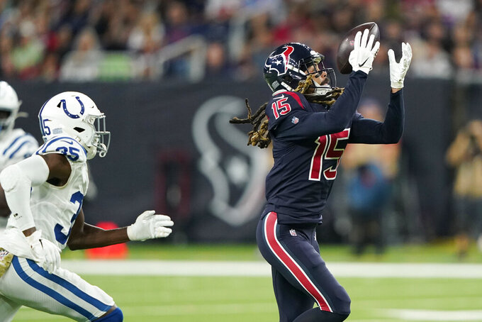 Houston Texans wide receiver Will Fuller (15) pulls in a catch in front of Indianapolis Colts cornerback Pierre Desir (35) during the first half of an NFL football game Thursday, Nov. 21, 2019, in Houston. (AP Photo/David J. Phillip)