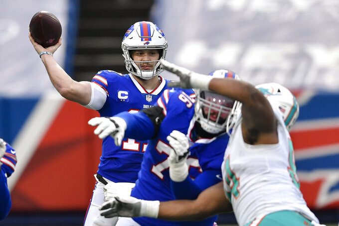 Buffalo Bills quarterback Josh Allen (17) passes in the first half of an NFL football game against the Miami Dolphins, Sunday, Jan. 3, 2021, in Orchard Park, N.Y. (AP Photo/Adrian Kraus)
