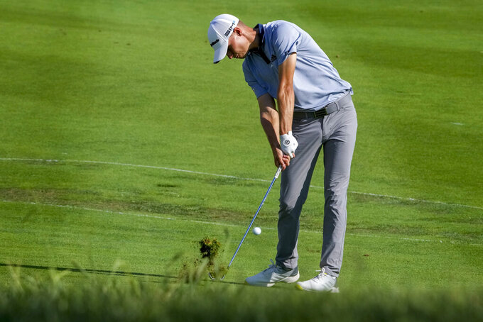 Nicolai Hojgaard of Denmark hits from the fairway during the fourth round of the Italian Open golf tournament, in Guidonia, in the outskirts of Rome, Sunday, Sept. 5, 2021. The Italian Open took place on the redesigned Marco Simone course just outside Rome that will host the 2023 Ryder Cup. (AP Photo/Andrew Medichini)