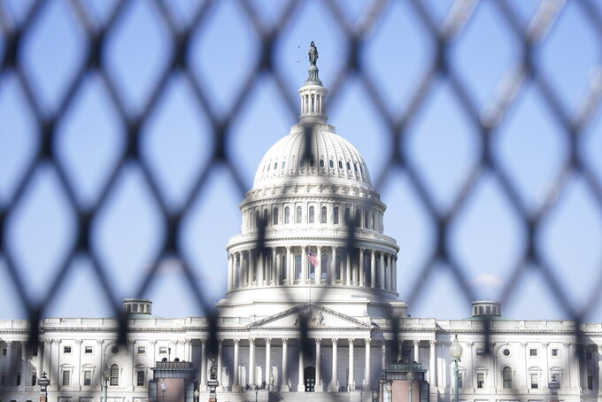 "The Capitol is seen through security fencing, Thursday, March 4, 2021, on Capitol Hill in Washington. Capitol Police say they have uncovered intelligence of a ""possible plot"" by a militia group to breach the U.S. Capitol on Thursday, nearly two months after a mob of supporters of then-President Donald Trump stormed the iconic building to try to stop Congress from certifying now-President Joe Biden's victory. (AP Photo/Jacquelyn Martin)"