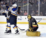 Vegas Golden Knights goaltender Marc-Andre Fleury (29) defends against St. Louis Blues center Oskar Sundqvist during the first period of an NHL hockey game Friday, Nov. 16, 2018, in Las Vegas. (AP Photo/David Becker)