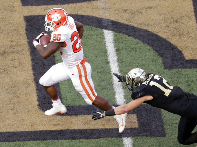 Clemson's Adam Choice (26) runs past Wake Forest's Luke Masterson (12) for a touchdown during the second half of an NCAA college football game in Charlotte, N.C., Saturday, Oct. 6, 2018. (AP Photo/Chuck Burton)