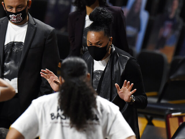 South Carolina head coach Dawn Staley talks to her players during the first half of an NCAA college basketball game against Vanderbilt Thursday, Jan. 14, 2021, in Nashville, Tenn. (AP Photo/Mark Zaleski)