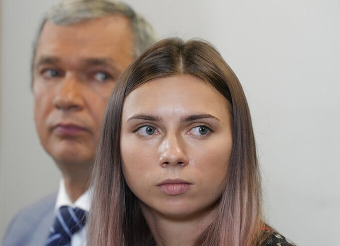 Belarusian dissident in Poland, Pavel Latushka, left, and Belarusian Olympic sprinter Krystsina Tsimanouskaya, right, who came to Poland fearing reprisals at home after criticizing her coaches at the Tokyo Games, talk to journalists in Warsaw, Poland, Thursday, Aug. 5, 2021. (AP Photo/Czarek Sokolowski)