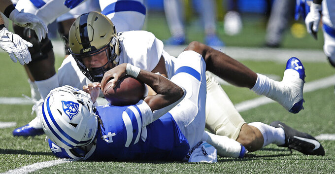 Georgia State quarterback Cornelious Brown IV (4) is tackled by Army linebacker Andre Carter II during the first quarter of an NCAA football game Saturday, Sept. 4, 2021, in Atlanta. (AP Photo/Ben Margot)