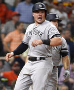 New York Yankees' Luke Voit reacts after scoring a run on Gary Sanchez's two run double during the sixth inning of a baseball game against the Houston Astros, Tuesday, April 9, 2019, in Houston. (AP Photo/Eric Christian Smith)