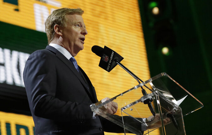NFL Commissioner Roger Goodell announces that Rashan Gary of Michigan will be headed to the Green Bay Packers during the first round at the NFL football draft, Thursday, April 25, 2019, in Nashville, Tenn. (AP Photo/Mark Humphrey)