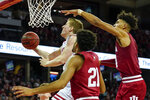 Wisconsin's Brevin Pritzl, left, shoots past Indiana's Jerome Hunter (21) and Aljami Durham, right, during the second half of an NCAA college basketball game Saturday, Dec. 7, 2019, in Madison, Wis. Wisconsin won 84-64. (AP Photo/Andy Manis)