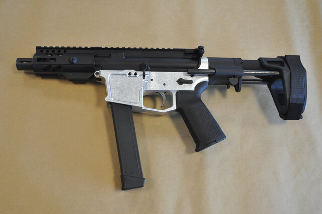 This undated image provided by the U.S. Attorney's Office in Seattle shows a homemade firearm that federal agents say was recovered on Feb. 6, 2020, from the Edmonds, Washington, home of Nathan Brasfield. In a criminal complaint unsealed in U.S. District Court, agents said that Brasfield had amassed an arsenal of homemade weapons despite being on federal supervision following his conviction on an earlier gun charge. (U.S. Attorney's Office via AP)