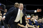 Marquette head coach Steve Wojciechowski talks to his team during the first half of an NCAA college basketball game against Seton Hall, Wednesday, March 6, 2019, in Newark, N.J. (AP Photo/Julio Cortez)