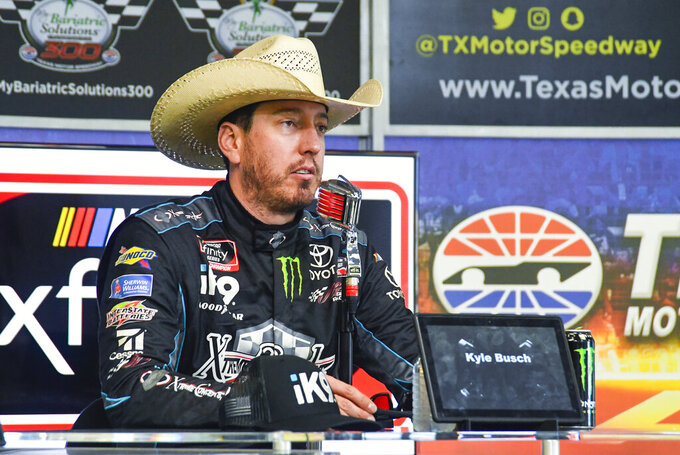 Driver Kyle Busch speaks to the media during a press conference after winning a NASCAR auto race at Texas Motor Speedway, Saturday, March 30, 2019, in Fort Worth, Texas. (AP Photo/Randy Holt)