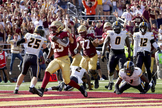 Boston College running back Travis Levy (23) rushes in for a touchdown ahead of Missouri defensive back Jaylon Carlies (1) during the second half of an NCAA college football game, Saturday, Sept. 25, 2021, in Boston. (AP Photo/Mary Schwalm)