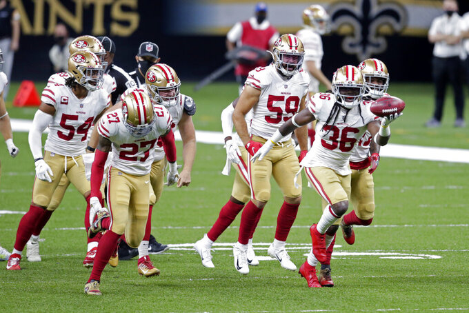 San Francisco 49ers Marcell Harris (36) reacts with teammates after recovering a muffed punt by New Orleans Saints wide receiver Deonte Harris in the first half of an NFL football game in New Orleans, Sunday, Nov. 15, 2020. (AP Photo/Butch Dill)