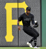 Pittsburgh Pirates center fielder Starling Marte pulls in a single hit by Cincinnati Reds' Alex Wood in the third inning of a baseball game Saturday, Aug. 24, 2019, in Pittsburgh. (Matt Freed/Post-Gazette via AP)
