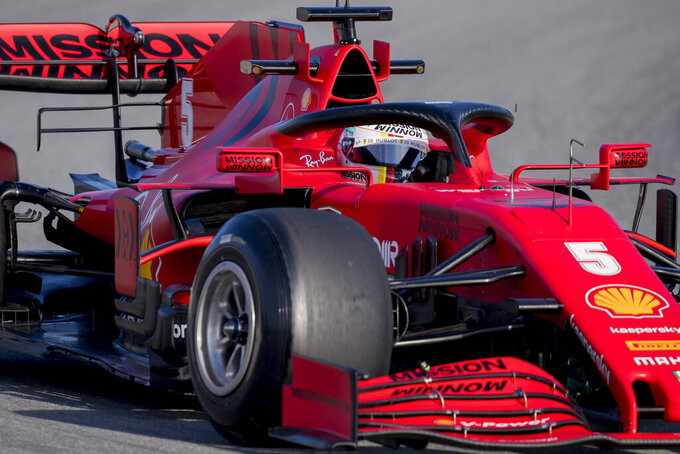 Sebastian Vettel steers his Ferrari during the Formula One pre-season testing session at the Barcelona Catalunya racetrack in Montmelo, outside Barcelona, Spain, Wednesday, Feb. 26, 2020. (AP Photo/Joan Monfort)