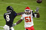 Baltimore Ravens quarterback Lamar Jackson (8) throws the ball in front of Kansas City Chiefs defensive end Michael Danna (51) during the second half of an NFL football game Monday, Sept. 28, 2020, in Baltimore. (AP Photo/Nick Wass)