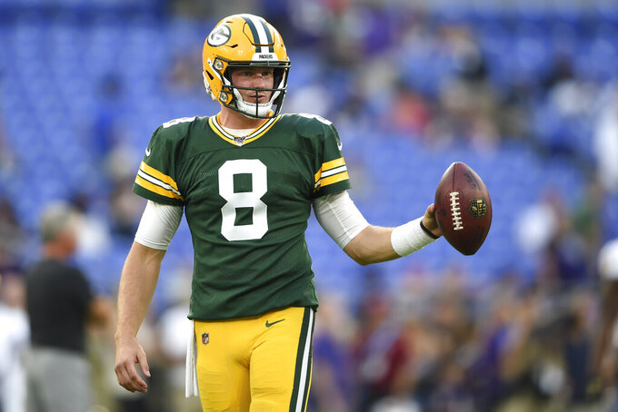 Green Bay Packers quarterback Tim Boyle works out prior to a NFL football preseason game against the Baltimore Ravens, Thursday, Aug. 15, 2019, in Baltimore. (AP Photo/Gail Burton)