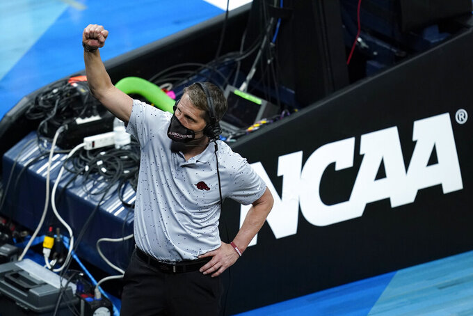 Arkansas head coach Eric Musselman celebrates after a Sweet 16 game against Oral Roberts in the NCAA men's college basketball tournament at Bankers Life Fieldhouse, Saturday, March 27, 2021, in Indianapolis. Arkansas won 72-70. (AP Photo/Darron Cummings)