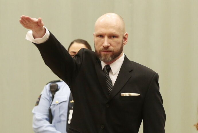 FILE - In this Tuesday, Jan. 10, 2017 file photo, Anders Behring Breivik raises his right hand at the start of his appeal case in Borgarting Court of Appeal at Telemark prison in Skien, Norway, Tuesday, Jan. 10, 2017. The manifesto that the presumed New Zealand shooter who killed at least 49 people in two mosques in Christchurch on Friday, March 15, 2019 published is shorter and