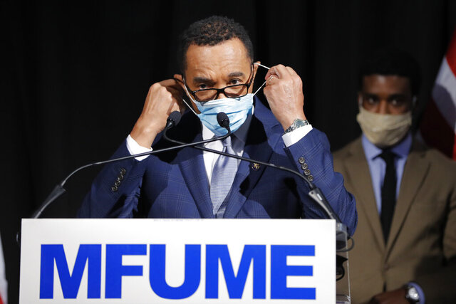 Democrat Kweisi Mfume removes a face mask before addressing reporters during an election night news conference after he won the 7th Congressional District special election, Tuesday, April 28, 2020, in Baltimore. Mfume defeated Republican Kimberly Klacik to finish the term of the late Rep. Elijah Cummings, retaking a Maryland congressional seat Mfume held for five terms before leaving to lead the NAACP. All voters in the 7th Congressional District were strongly urged to vote by mail in an unprecedented election dramatically reshaped by the coronavirus pandemic. (AP Photo/Julio Cortez)