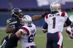 FILE - In this Sunday, Sept. 20, 2020, file photo, Seattle Seahawks linebacker Bruce Irvin, letft, is blocked by New England Patriots offensive guard Joe Thuney as he pressures quarterback Cam Newton (1) during the first half of an NFL football game, in Seattle. A big part of the success the Patriots have enjoyed on offense this season has to do with the discipline of its offensive line. (AP Photo/Elaine Thompson, File)