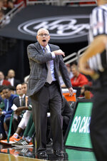 Miami head coach Jim Larranaga argues with a game official during the second half of an NCAA college basketball game against Louisville in Louisville, Ky., Sunday, Jan. 6, 2019. Louisville won 90-73. (AP Photo/Timothy D. Easley)