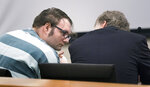 In this Tuesday, June 4, 2019 photo, Dakota Reed consults with his attorney before he is sentenced to a year in jail at Snohomish County Courthouse in Everett, Wash.  Reed discussed plans on Facebook for a mass shooting at a synagogue, police in Washington used a new law to quickly seize his 12 firearms, long before he was convicted of any crime.  (Andy Bronson/The Herald via AP)