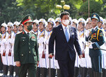 Vietnamese Defense Minister Phan Van Giang, left, and Japanese Defense Minister Nobuo Kishi review honor guards in Hanoi, Vietnam Sunday, Sept. 12, 2021. Japan can now give defense equipment and technology to Vietnam under an agreement signed Saturday, as the two countries step up their military cooperation amid worries about China's growing military influence. (Nguyen Trong Duc/ VNA via AP)