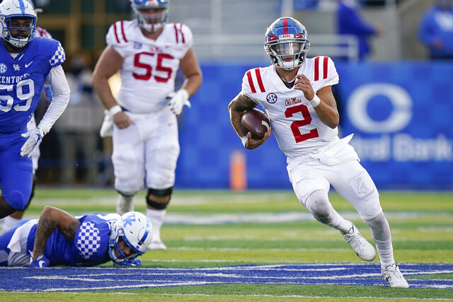 Mississippi quarterback Matt Corral (2) runs with the ball during the second half of an NCAA college football game against Kentucky, Saturday, Oct. 3, 2020, in Lexington, Ky. (AP Photo/Bryan Woolston)