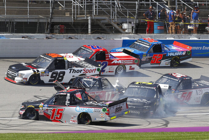 FILE - This Aug. 10, 2019, file photo, Tyler Ankrum (17), Anthony Alfredo (15), Jordan Anderson (3) and Natalie Decker (54), crash during a restart of a NASCAR Truck Series race at Michigan International Speedway in Brooklyn, Mich. The underappreciated Truck Series opens NASCAR's championship weekend with an under the lights Friday night, Nov. 6, 2020,  shootout that could be the most entertaining event at Phoenix Raceway. The path to the winner-take-all finale has been a flat-out demolition derby with two consecutive weeks of wild driving.(AP Photo/Paul Sancya, File)