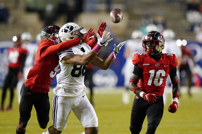 Western Kentucky defensive back Dominique Bradshaw (9) breaks up a pass to BYU wide receiver Keanu Hill (86) as Western Kentucky defensive back Kendrick Simpkins (16) watches during the first half of an NCAA college football game Saturday, Oct. 31, 2020, in Provo, Utah. (AP Photo/Rick Bowmer, Pool)