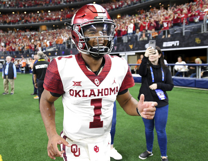 Oklahoma quarterback Kyler Murray (1) celebrates after beating Texas 39-27 in the Big 12 Conference championship NCAA college football game on Saturday, Dec. 1, 2018, in Arlington, Texas. (AP Photo/Jeffrey McWhorter)