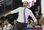 FILE - In this Jan. 5, 2019, file photo, Washington head coach Mike Hopkins calls to his team during the second half of an NCAA college basketball game against Washington State, in Seattle. Hopkins was named Coach of the Year in the Pac-12 Conference, Tuesday, March 12, 2019. (AP Photo/Ted S. Warren, File)