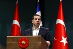 Greece's Prime Minister Alexis Tsipras speaks during a press conference with Turkey's President Recep Tayyip Erdogan at the Presidential Palace in Ankara, Tuesday, Feb. 5, 2019. Tsipras and Erdogan are set to discuss an array of subjects that have strained relations between the two NATO allies, including territorial disputes in the Aegean Sea and gas exploration in the eastern Mediterranean. (AP Photo/Burhan Ozbilici)