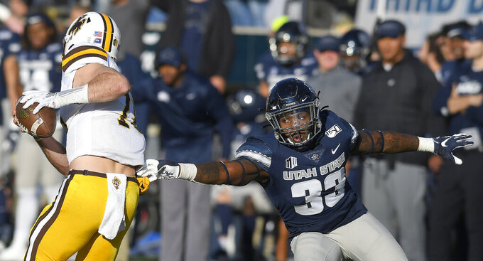 Utah State holds off Wyoming 26-21