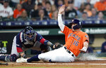 FILE - This May 24, 2019, file photo shows Houston Astros' Aledmys Diaz (16) scoring as Boston Red Sox catcher Sandy Leon reaches to tag him at home plate during the second inning of a baseball game in Houston. The Astros were scheduled to play the Red Sox in the first of consecutive weekend series matching teams that fired World Series-winning managers in the aftermath of a sign-stealing scandal. (AP Photo/David J. Phillip, File)