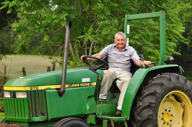 In this photo provided by Larry Robinson, his father-in-law James Eubaun Richardson rides a tractor at his home in Jacksboro, Tenn., on July 30, 2014. Richardson, one of the few surviving members of the World War II jungle-fighting unit known as Merrill's Marauders, died on Sunday, Dec. 27, 2020, at age 99 of complications from a respiratory illness, according to his daughter, Judy Robinson. He earned a dozen medals during the war, including a Purple Heart and the Bronze Star. (Larry Robinson via AP)