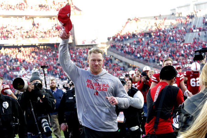 Nebraska head coach Scott Frost tips his cap to spectators as he runs off the field following the team's first win of the season in an NCAA college football game against Minnesota in Lincoln, Neb., Saturday, Oct. 20, 2018. (AP Photo/Nati Harnik)
