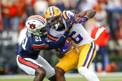LSU wide receiver Terrace Marshall Jr. (6) is tacked by Auburn defensive back Smoke Monday (21) after a reception during the first quarter of an NCAA college football game on Saturday, Oct. 31, 2020, in Auburn, Ala. (AP Photo/Butch Dill)