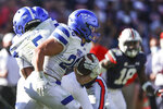 Georgia State running back Tucker Gregg (26) carries the ball against Auburn during the first half of an NCAA college football game Saturday, Sept. 25, 2021, in Auburn, Ala. (AP Photo/Butch Dill)