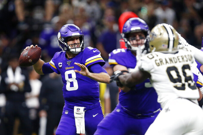 Minnesota Vikings quarterback Kirk Cousins (8) passes under pressure from New Orleans Saints defensive end Carl Granderson (96) in the first half of an NFL wild-card playoff football game, Sunday, Jan. 5, 2020, in New Orleans. (AP Photo/Butch Dill)