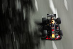 Red Bull Racing driver Daniel Ricciardo of Australia steers his car during second practice at the Marina Bay City Circuit ahead of the Singapore Formula One Grand Prix in Singapore, Friday, Sept. 14, 2018. (AP Photo/Yong Teck Lim)