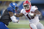 Georgia running back Elijah Holyfield (13) stiff arms Kentucky safety Mike Edwards (7) during the second half an NCAA college football game in Lexington, Ky., Saturday, Nov. 3, 2018. (AP Photo/Bryan Woolston)