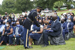 The Honor Guard presents the flag that was on his casket to his son, John-Miles Lewis, at the burial service for Rep. John Lewis at South-View Cemetery in Atlanta Thursday, July 30, 2020. (Alyssa Pointer/Atlanta Journal-Constitution via AP, Pool)