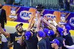 Norfolk State players celebrate with the trophy after beating Morgan State in an NCAA college basketball game in the championship of the Mid-Eastern Athletic Conference tournament at the Scope Arena on Saturday, March 13, 2021, in Norfolk, Va. (AP Photo/Mike Caudill)