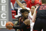 Stanford guard Daejon Davis, left, looks to pass while pressured by Washington State guard Jervae Robinson during the second half of an NCAA college basketball game in Pullman, Wash., Sunday, Feb. 23, 2020. Stanford won 75-57. (AP Photo/Young Kwak)