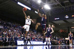 Gonzaga guard Ryan Woolridge (4) shoots while pressured by Detroit Mercy forward Chris Brandon (21) during the second half of an NCAA college basketball game in Spokane, Wash., Monday, Dec. 30, 2019. (AP Photo/Young Kwak)
